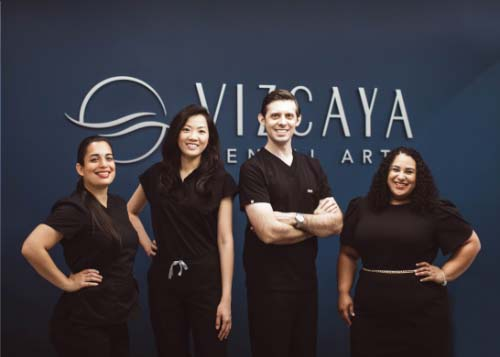 Picture of Dr. Kottar, Dr. Hong and their team in their state-of-the-art dental office.